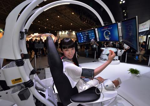 Japan's electronics giant Sharp unveils the prototype model of the health care chair which has various vital sensors of temperature, pulse waves, blood presure, body weight and others and communicate with health care facilities at the Ceatec electronics trade show in Chiba, Tokyo on October 1, 2013. Asia's largest electronics trade show Ceatec will run from October 1-5 and exhibit some of the latest electronics technology products.