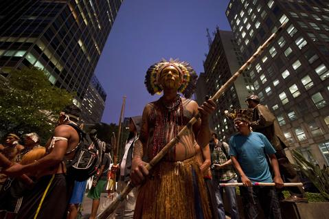 Indigenous Brazilians march along Paulista Avenue in Sao Paulo, Brazil on October 2, 2013, at the beginning of the National Indigenous Mobilization Week. Indigenous people from several ethnic groups take part in a protest to demand more support from the federal government.