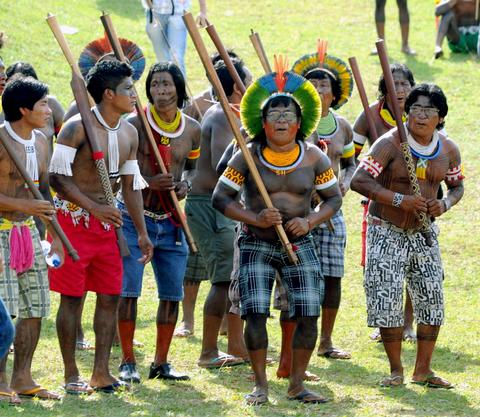 Brazilian natives dance during a demo in front of the National Congress in Brasilia on October 2, 2013. Indigenous people from several ethnic groups will concentrate in the Brazilian capital to demand more support from the federal government during the National Indigenous Mobilization Week.