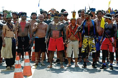 Brazilian natives wait for a possible meeting with the president of the Deputies chamber, outside the National Congress in Brasilia on October 2, 2013. Indigenous people from several ethnic groups will concentrate in the Brazilian capital to demand more support from the federal government during the National Indigenous Mobilization Week.