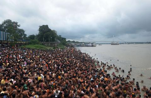 "Indian Hindu devotees perform 'Tarpan', rituals to pay obeisance to one's forefathers on the last day of ""Pitrupaksh"" - days for offering prayers to ancestors - on the banks of the River Ganges in Kolkata on October 4, 2013. In Hindu mythology this day is also called 'Mahalaya' and describes the day when the gods created the ten armed goddess Durga to destroy the demon king Asura who plotted to drive out the gods from their kingdom. The five-day period of worship of Durga, who is attributed as the destroyer of evil, commences on October 9."