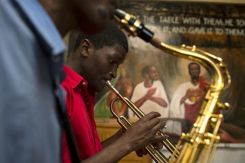 A man plays an instrument during a training session held as part of a programme by the Orchestra of Ghetto Classics in the Korogocho slum of Nairobi October 6, 2013. The orchestra, in partnership with the Art of Music Foundation and the St. John's Catholic Church, started the project with the aims of teaching music to the youths living in the slum and providing them with income opportunities from the skills they learn.