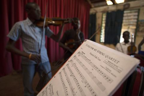 A music score sheet is pictured during a violin class held as part of a programme by the Orchestra of Ghetto Classics in the Korogocho slum of Nairobi October 6, 2013. The orchestra, in partnership with the Art of Music Foundation and the St. John's Catholic Church, started the project with the aims of teaching music to the children and youths living in the slum and providing them with income opportunities from the skills they learn.