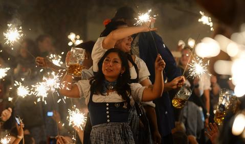 Waitresses celebrate the end of this year's Bavarian Oktoberfest beer festival at the Theresienwiese in Munich, during the last evening on October 6, 2013.