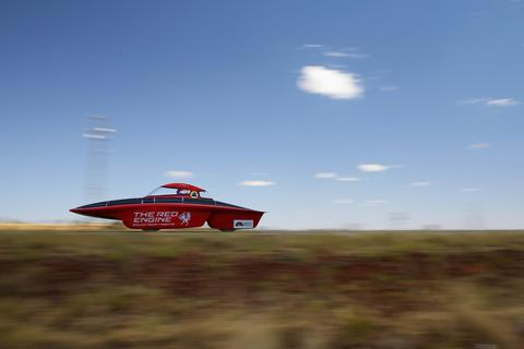 The RED Engine from the Solar Team Twente, University of Twente and Saxion in the Netherlands races in the Clipsal and Schneider Electric Challenger Class on Day 2 on October 7, 2013 near Tennant Creek, Australia. Over 25 teams from across the globe are competing in the 2013 World Solar Challenge - a 3000 km solar-powered vehicle race between Darwin and Adelaide. The race began on October 6th with the first car expected to cross the finish line on October 10th.