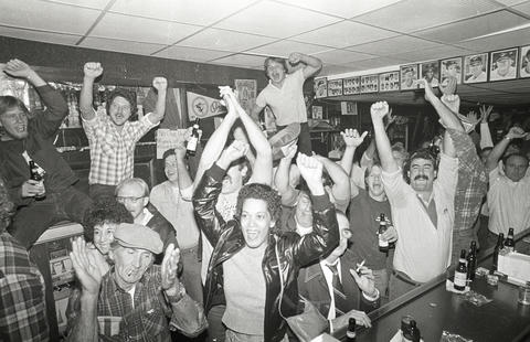 Fans celebrate at a bar as the Orioles win the 1983 World Series.