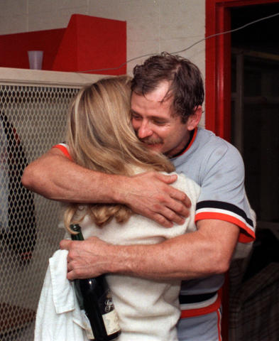 Orioles catcher Rick Dempsey gets a hug from his wife in the clubhouse after the Orioles won the 1983 World Series.