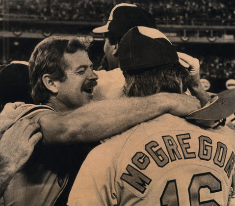 Catcher Rick Dempsey hugs pitcher Scott McGregor after the Orioles beat the Phillies to win the World Series.