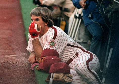Philadelphia's Pete Rose looks on from the dugout.