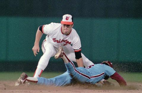 Cal Ripken Jr. tries to tag out Philadelphia's Joe Morgan at second base.