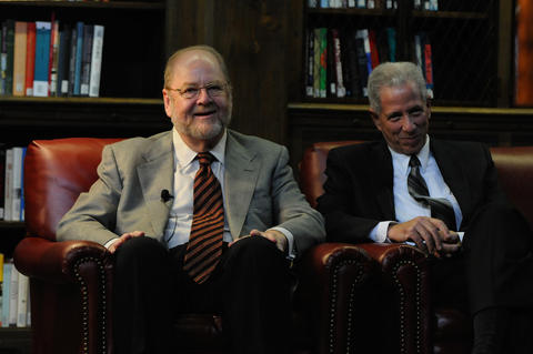 Rothman left, sits with the dean of the medical school Robert Alpern before being introduced.