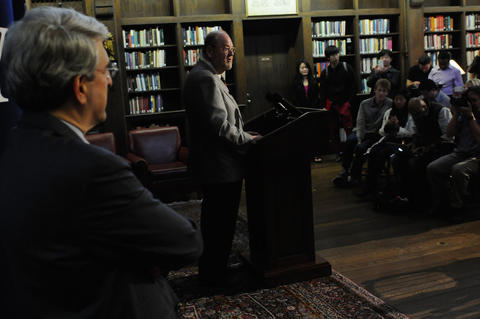 Rothman speaks as  the President of Yale University Peter Salovey looks on.