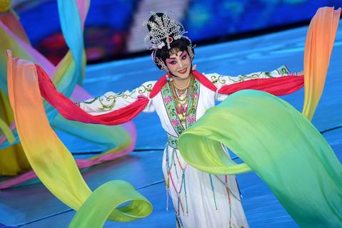 A Chinese Beijing Opera actor performs during the opening ceremony of the East Asian Games at a gymnasium in Tianjin on October 6, 2013. More than 2,400 athletes from nine countries are set to take part in the multi-sport event in the harbour city of Tianjin, competing in 24 different sports.