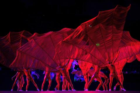 Chinese artists perform during the opening ceremony of the East Asian Games at a gymnasium in Tianjin on October 6, 2013. More than 2,400 athletes from nine countries are set to take part in the multi-sport event in the harbour city of Tianjin, competing in 24 different sports.