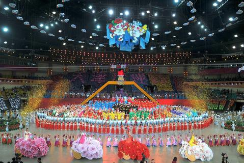 Chinese dancers perform during the opening ceremony  of the East Asian Games at a gymnasium in Tianjin on October 6, 2013. More than 2,400 athletes from nine countries are set to take part in the multi-sport event in the harbour city of Tianjin, competing in 24 different sports.