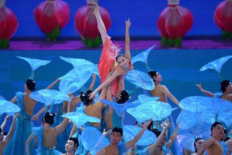 Chinese  performers take part in the opening ceremony of the East Asian Games at a gymnasium in Tianjin on October 6, 2013. More than 2,400 athletes from nine countries are set to take part in the multi-sport event in the harbour city of Tianjin, competing in 24 different sports.
