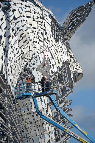 Work continues on The Kelpies sculptures at the eastern entrance to the Forth and Clyde canal on October 9, 2013 in Falkirk, Scotland. The two Kelpie heads are positioned at a specially constructed canal lock and basin part of the Helix project, each weighing 300 tonnes and standing 100 feet tall. The structure was designed by sculptor Andy Scott as a monument to horse powered heritage across Central Scotland.