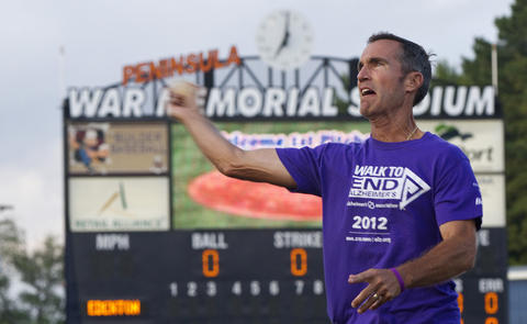 Jim Garner throws out the first pitch during Alzheimer's Awareness Night at a Peninsula Pilots game on August 1. Jim, 51, was diagnosed with early-onset Alzheimer's disease three years ago.