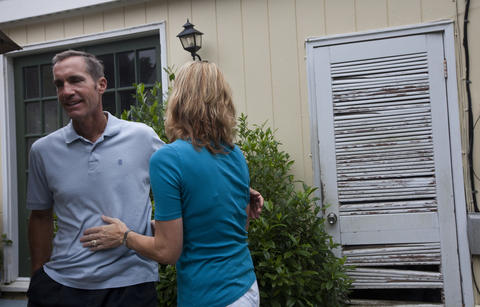 Jim and Karen Garner embrace while discussing the progression of Jim's early-onset Alzheimer's disease at their home in early August. Jim, 51, was diagnosed with early-onset Alzheimer's disease three years ago. His mother died of the disease at 61, his brother at 52.