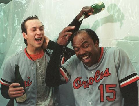 Cal Ripken Jr.and Dan Ford celebrate in the clubhouse after winning the World Series.