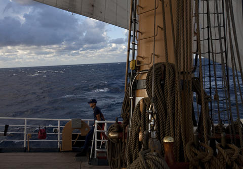 Boatswain's Mate A School student Rick Morales attempts to stave off seasickness as eight-foot waves toss the Coast Guard Barque Eagle on Tuesday morning.