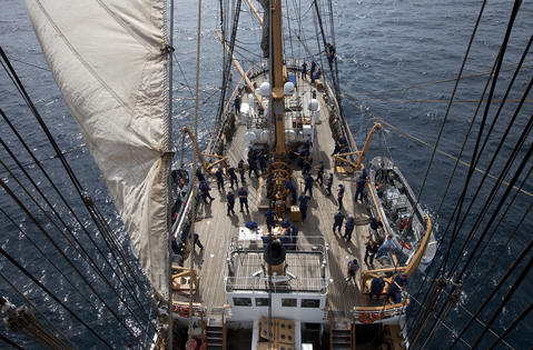 "Crew members, officer candidates and students from the Boatswain's Mate ""A"" School prepare to raise the sails of the Coast Guard Barque Eagle on Monday afternoon."