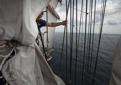 Crew member Luis Escobosa prepares to set a sail on the Coast Guard Barque Eagle on Monday afternoon.