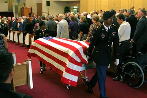 "Honor Guard departs from Bethel Baptist Church during the funeral for Sgt.. Caryn Reynal Nouv of Newport News, she was killed in Afghanistan July 27th. The burial was at Suffolk's Veterans Cemetery with full military honors and ""Firing the three rifle-volley""."