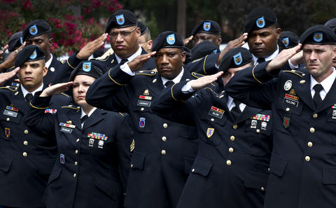 "Troops from Ft. Eustis give as hand salute as the Honor Guard passed.  The funeral for Sgt.. Caryn Reynal Nouv of Newport News, she was killed in Afghanistan July 27th. The burial was at Suffolk's Veterans Cemetery with full military honors and ""Firing the three rifle-volley""."