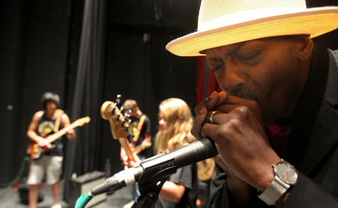 Blues Camp instructor and founder Fernando Jones joins in a jam with his students on harmonica during a rehearsal at the American Theater.