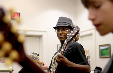 "Local musician William ""MoBetta"" Ledbetter rehearses with his group at during the Fernando Jones Blues Camp at the American Theater in Hampton."