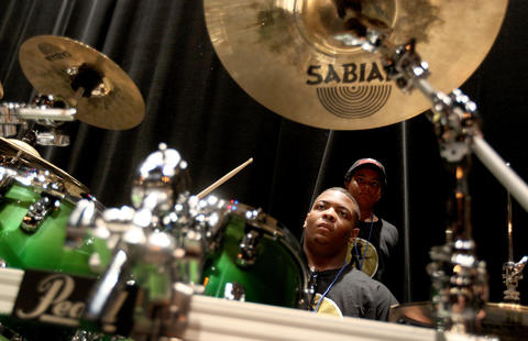 Janes Sims of Chicago keeps time on the drums during a rehearsal session at the Fernando Jones Blues Camp being held at the American Theater this week.