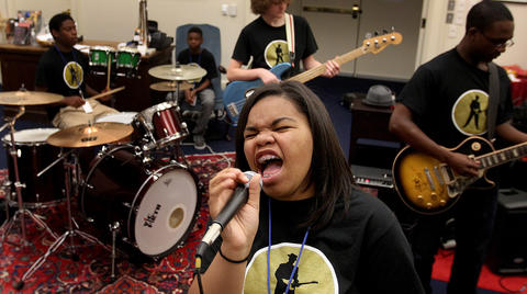 "Christina Jefferson works on belting out tunes like ""The Thrill is Gone"" by BB King and ""The Mess Around"" by Ray Charles during rehearsal at the blues camp being held at the American Theater."
