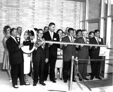 Turning a huge key opening the new Dominick's Finer Foods store in Park Ridge on July 18, 1961, are Dominick Di Mattio, Sr.; from left, Joseph M. Ciaccio, vice president of Dominick's Finer Foods; William Benjamin, builder of the store; Michael Guinto, also a Dominick's vice president; E.A.Lundberg, president of the Park Ridge Chamber of Commerce; and Dominck DiMatteo, Jr., president of Dominick's chain.