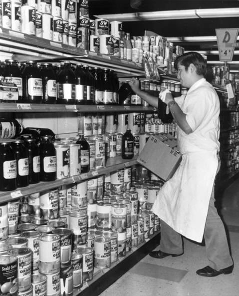 Ralph Madrigal, stock boy on the night crew, loads shelves at the Dominicks at 6009 N. Broadway