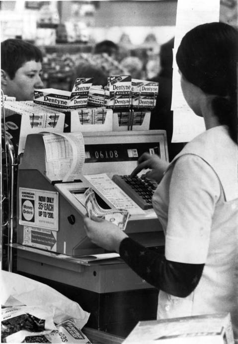 The cash register may indicate rising food prices as a shopper checks out at Dominicks at Elmdale and Broadway.