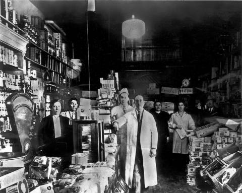 Dominick DiMatteo Sr., center, stands with family members and customers in 1935 in his first store, at 3832 West Ohio St. He gave it his first name to make it homey.