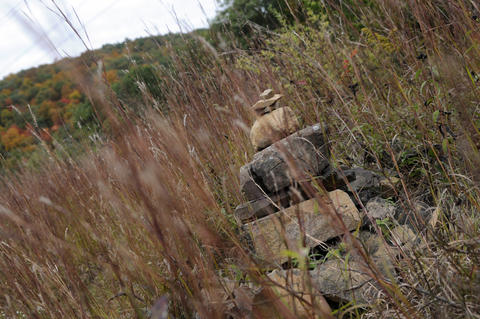 A Cairns, or a stone pile, sits in the area along the trail cleared for the high tension wires.