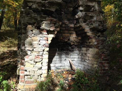 The ruins of an old chimney greets those preparing to climb to the top of Beseck Mountain.