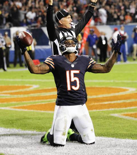 Chicago Bears wide receiver Brandon Marshall (15) celebrates his touchdown against the New York Giants, during the first half of their game at Soldier Field, in Chicago.