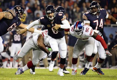 Chicago Bears quarterback Jay Cutler (6) scrambles in the first quarter.