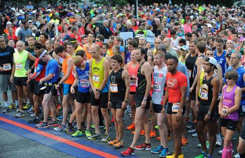 The 2013 Baltimore Marathon runners take their mark at the strating line as the race os about to start in the 13th Annual Baltimore Running Festival.