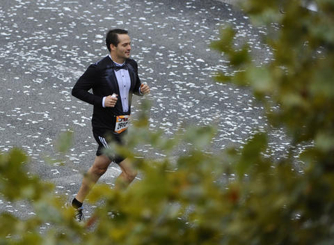 A tuxedo shirted Michael Nash got a late start during the 2013 Baltimore Marathon during the 13th Annual Baltimore Running Festival.