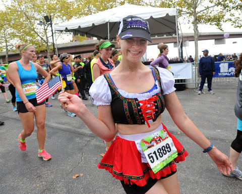 Allison Pezzullo, of Columbia, dressed in a dirndl, a traditional German dress, for the half marathon during the 13th Annual Baltimore Running Festival.