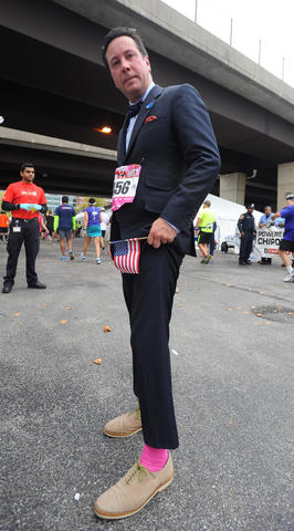 Craig Martin, of Rodgers Forge, ran in a relay for the 2013 Baltimore Marathon dressed in a custom-made suit, bow tie and dress shoes.
