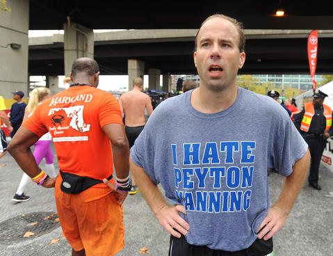 "Rick Stewart, of Phoenix, Md., finished the half marathon in an ""I hate Peyton Manning"" t-shirt."