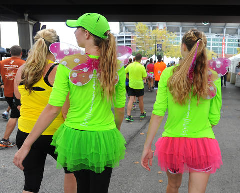 Cross Country runners for Severn School Lexi Schrobilgen, left, and Katie Pawlikowski, both 16, dressed as winged fairies to run in the half marathon during the 13th Annual Baltimore Running Festival.