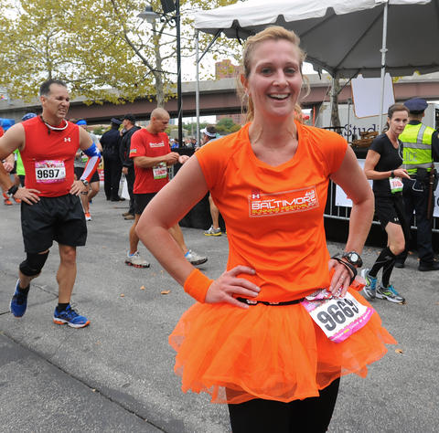 Kara Cristaldi, of Silver Spring, dressed in an orange tutu to run in a relay of the 2013 Baltimore Marathon.