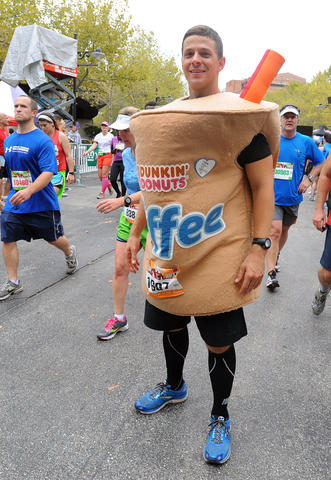 Jeremy Gruver of Dover, Pa., ran the full 2013 Baltimore Marathon dressed as a Dunkin' Donuts iced coffee. He won the Facebook contest in which the donut store paid his $110 entry fee if he ran with the store costume.