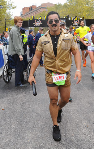 Jonathan H., of Baltimore, dressed as Lt. Dangle on the TV show Reno 911, to run in the half marathon.